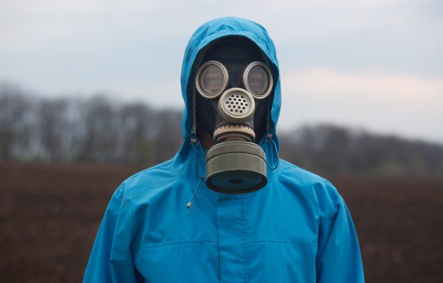 portrait of ecologist working outdoors wearing gas mask and uniform scientist explores surroundings scientist works in open air 176532 9824